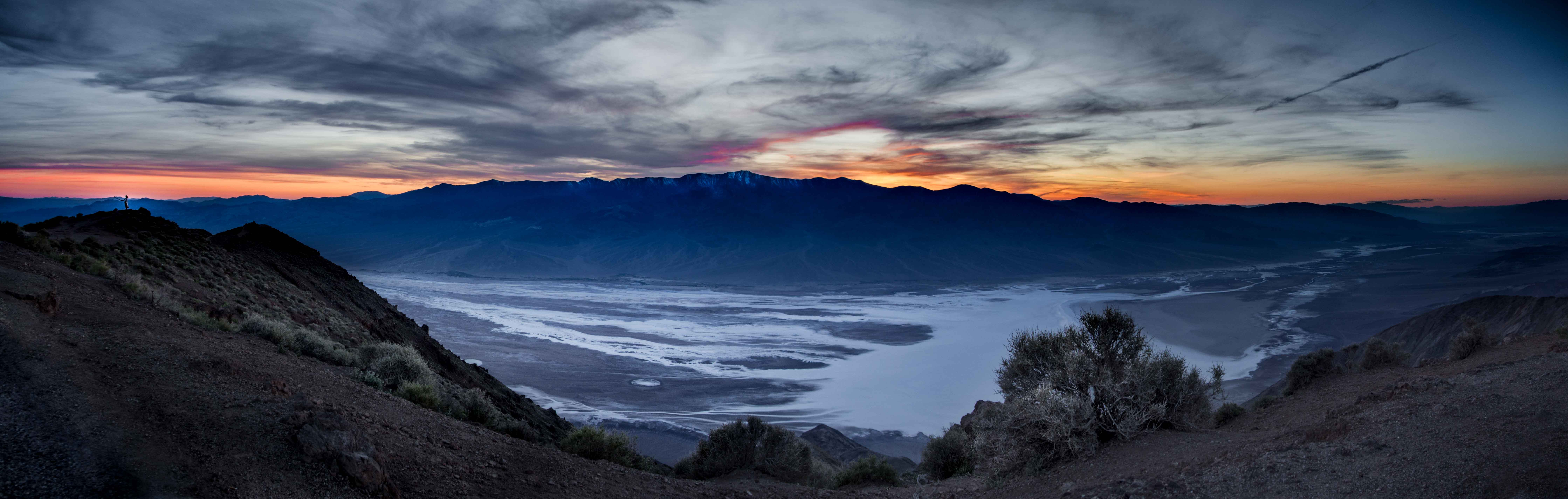 A panorama of a sunset's last breath over the salt flats of Death Valley.